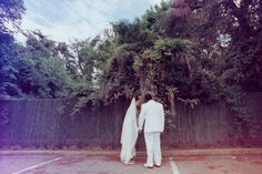 Bridal portraits. Lauren + AJ Backyard Indie Bohemian Long Island Wedding. Dress and veil: Lindsey Thornburg. Photographer: Chellise Michael Photography in Brooklyn, NYC. Film double exposure light leak