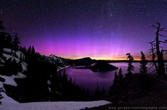Photographer Brad Goldpaint took this incredibly lovely picture of a pink aurora over Crater Lake, Oregon. Click for more info on it, including why it's pink!
