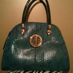 NWT ..Emerald Green Handbag Large emerald green pocketbook trimmed in gold..with handles..beautiful bag! Bags Shoulder Bags