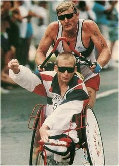 Team Hoyt: Dick Hoyt has completed over 1000 races with his son Rick Hoyt who is paralyzed, including an Ironman Triathlon in which he pulled him 2.4 miles in a boat while swimming, rode 112 miles with him the front of his bicycle, and then 26.2 miles of pushing him in his wheelchair while he ran. The ultimate example that NOTHING is impossible. SHARE if you find this Inspiring. #GTDC #Triathlete