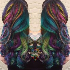 Rainbow goddess oil slick style loved creating this look! I applied a level 4 Jack Winn Color to her roots the lightened peices all through but leaving some dark with @jackwinncolor #lightner 30 volume with @brazilianbondbuilder then applied a series of my favorite colors all over. #arcticfoxhaircolor #manicpanic #pravana #lunatikhairdye #scruples
