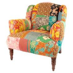 Crafted from beautiful patchwork pieces of kantha work fabric, this exotic chair is the perfect addition to your bohemian reading nook. Arrange alongside a gold finished lantern, carved wood side table and handmade rug to complete your cosy retreat.  Product: ChairConstruction Material: Fabric and woodColour: Orange, blue, red and pinkDimensions: 84 cm H x 86 cm W x 94 cm DCleaning and Care: Clean with damp cloth