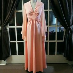 "VINTAGE - 70's Peach Butterfly Sleeve Evening Gown Gown is in excellent pre loved condition, without rips, holes, snags or stains. There are, however imperfections even with its perfected beauty in the images. 3 hook eyes are missing for the hook locks. 2 at the top of the zipper closer and one mid lower back. If you look at the pictures taken, you'll notice that it does NOT affect it's overall beauty.  Flat Measurements  Bust 16"" Waist 14"" Vintage Dresses Maxi"
