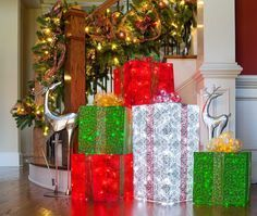 Create DIY Lighted Gift boxes using chicken wire, string lights and whimsical fabric, the result is an eye catching indoor or outdoor Christmas display!