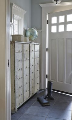 "entryway:  gorgeous Craftsman door, trim work and cool vintage metal lockers for a ""mudroom"""