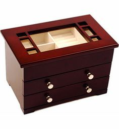 Glass Top Wooden Jewelry Box stylishly organizes and stores your fine jewelry with its walnut finish design and nickle hardware.