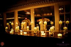 nighttime glow, candlescape, orchids by Soiree Floral at Galley Beach. photo by LifeFusion Photography