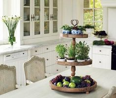Classic kitchen. Centerpiece : plants and fruits.