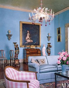 An 18th-century Murano chandelier hangs in the blue room | archdigest.com