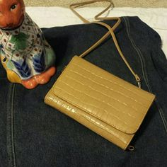Wallet Tan, roomy snake like design organizer. Strap comes off. Bags Wallets