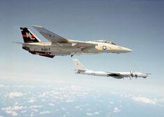VF-51 Screaming Eagles F-14 Tomcat inviting a Russian Bear Bomber to vamoose