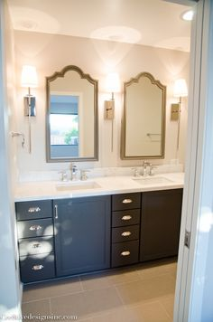 Bathroom remodel using Lowes cabinets and Restoration Hardware medicine cabinets.