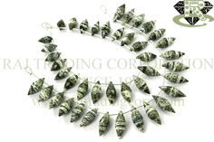 Green Zebra Jasper Faceted Dew Drops (Quality AA) Shape: Dew Drops Faceted Length: 18 cm Weight Approx: 13 to 15 Grms. Size Approx: 6x13 to 7x19 mm Price $28.44 Each Strand