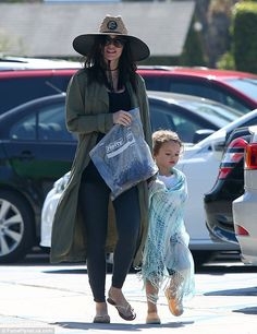 Beach day: Pregnant Megan Fox covered up her bump in long jacket and leggings during a family day at the beach in Malibu with husband Brian Austin Green and their two boys Noah and Bodhi