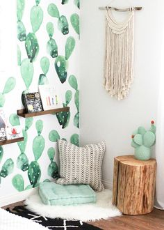 this corner because the perfect spot for a reading nook, with floor pillows, wall shelves, and a fun cactus lamp | thelovedesignedlife.com