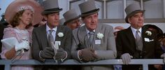 Grey top hat and tails. I think they do it better in the Forsythe Sagas - sorry Bond!