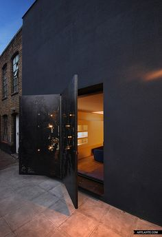 "Residential Architecture: Hidden House by Teatum+Teatum: "".Perforated steel doors fold open like the wings of a butterfly at the backstreet entrance to this London house by architects Teatum+Teatum.the residence is squeezed between two existing building Residential Architecture, Interior Architecture, Interior And Exterior, Black Architecture, Online Architecture, Contemporary Architecture, Interior Design, Hidden House, London House"