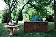 """Don't forget the adults when hosting a child's birthday party. This darling train-themed party included a place for adults to """"wet their whistle,"""" and our wooden cake table provided a great place to display favors for the guests. Trains Birthday Party, Train Party, 2nd Birthday, Birthday Parties, Wooden Cake, Of Mice And Men, Party Activities, Childrens Party, Party Themes"""