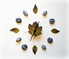 Hey, I found this really awesome Etsy listing at https://www.etsy.com/listing/205327726/clock-stones-and-leaves-wall-clock