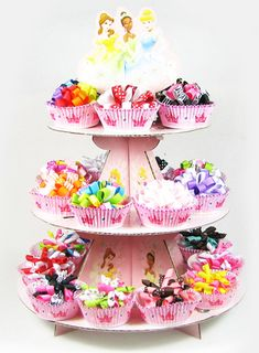 All you need is a cupcake stand , some girly cupcake baking cups and your products.