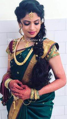 Neha looks elegant for her Varapooje function. Makeup and hairstyle by Vejetha for Swank Studio. Berry lips. South Indian bride. Eye makeup. Bridal jewelry. Bridal hair. Fishtail braid. Silk sari. Bridal Saree Blouse Design. Indian Bridal Makeup. Indian Bride. Gold Jewellery. Statement Blouse. Tamil bride. Telugu bride. Kannada bride. Hindu bride. Malayalee bride. Find us at https://www.facebook.com/SwankStudioBangalore
