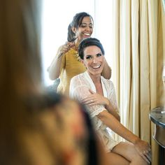 Glowing with make-up from Charlotte Tilbury, Alexandra shares laughs before her wedding.