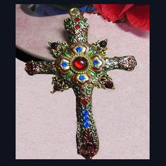 Elaborate cross with faux jewels pendant. by VINTAGEJOOLSFORYOU