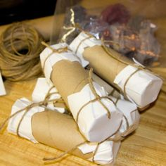 I have been saving our dryer lint and decided to give it a try. Here's what I used, TP rolls and other paper tubes. junk mail and twine. I don't know why, since you catch them on fire and they are gone forever… but I wanted them to be cute! So I stuffed the rolls, cut small squares from the junk mail, placed thepaperover the both ends of the tubes and tied them off with twine.