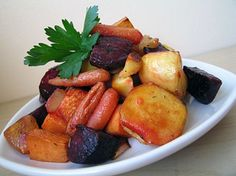 The roasting makes these veggies extra sweet and even people who don't like beets or parsnips usually love this dish. You might want to line the baking sheets with parchment or use a Silpat mat.