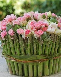 table bouquet from QUE BUENO ES VIVIR!! ... asparagus spears cover vase filled small pink and white flowers ...