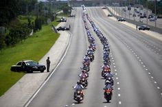 Hundreds of motorcycle officers lead the funeral procession of Jupiter Police Officer Bruce St. Laurent, Friday, September 14, 2012, in Palm Beach Gardens, Florida. Officer St. Laurent, a 20-year veteran police officer, was killed in a crash during a motorcade for President Barack Obama last week.