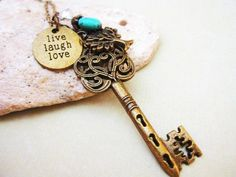 Ornate Key Necklace with affirmation charm, tree, crystal and turquoise stone accent. $9.99, via Etsy.