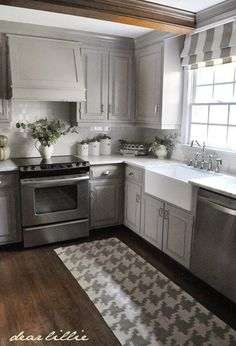 "Gray painted kitchen cabinets with marble countertops and wood floor. Soft and subtle. And love the integrated range hood  <a class=""pintag searchlink"" data-query=""%23marblecountertops"" data-type=""hashtag"" href=""/search/?q=%23marblecountertops&rs=hashtag"" rel=""nofollow"" title=""#marblecountertops search Pinterest"">#marblecountertops</a> <a class=""pintag searchlink"" data-query=""%23graycabinets"" data-type=""hashtag"" href=""/search/?q=%23graycabinets&rs=hashtag"" rel=""nofollow"" title=""#graycabinets search Pinterest"">#graycabinets</a> <a class=""pintag searchlink"" data-query=""%23rangehood"" data-type=""hashtag"" href=""/search/?q=%23rangehood&rs=hashtag"" rel=""nofollow"" title=""#rangehood search Pinterest"">#rangehood</a>"