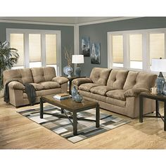 Signature Design by Ashley® Parkton Mocha Set. Love the wall color with the beige furniture.