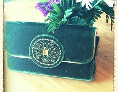 Check out this item in my Etsy shop https://www.etsy.com/listing/287896277/stunning-unique-green-velvet-clutch-from