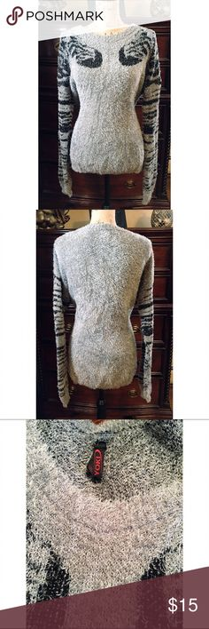 NWOT Yoki Gray Zebra Fuzzy Sweater size XL NWOT This sweater is so soft & fuzzy it feels like a teddy bear. Its light gray color with dark gray zebra striped long sleeves. It also has some stretch and is figure flattering. Yoki Sweaters Crew & Scoop Necks