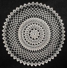 https://flic.kr/p/7uLKGi   Midnight Sun Doily   Designer: C. Strohmeyer. Source: LA Leaflet 962, Elegant Crocheted Doilies. Thread: Aunt Lydia 10. Color: #226 Natural. Hook: Don't remember. Size: 18.5 inches dia. Made: Either in 2007 or 2008.