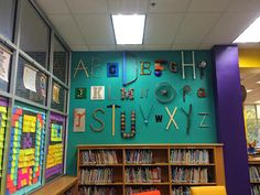 Alphabet Wall--have people look around and help find items to make the wall.  Over by reading steps or new wall???