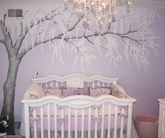 Artistic purple baby nursery room decoration with light purple cherry blossom wall mural. Including white wood baby box and light purple baby bedding exciting wall decoration. Baby Bedroom, Nursery Room, Girls Bedroom, Nursery Murals, Room Baby, Nursery Wallpaper, Tree Wallpaper, Wallpaper Decor, Baby Girl Rooms