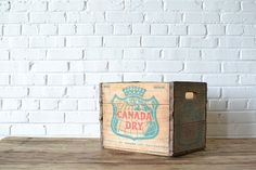 Vintage wooden crate with the original advertising artwork from Canada Dry ginger ale.  Great prop for catering or product shoots!