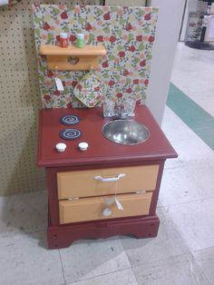 What a cute find! Homemade kid kitchen