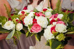 bouquet of peonies, ranunculus, garden roses, and various greens