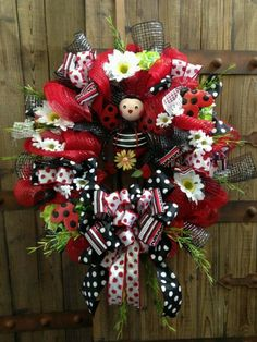 """I need this ladybug wreath for my door...the snowman """"welcome"""" sign is starting to draw ire from those who visit, lol"""