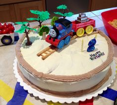 Thomas the Train bday cake! So fun to decorate with pretzel stick tracks, my son's trees from his train sets, and 'Celebration Thomas' train. My first attempt at baking a cake this size. 4 boxes of Funfetti with homemade frosting. So moist and yummy!