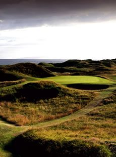 Royal Troon, Scotland.  Stern but fair golfing experience. Home club of The Postage Stamp.