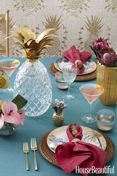 Set a table with gilded pineapples and palm baubles to evoke balmy breezes during dinner. Click through for more table setting decorations and centerpieces.