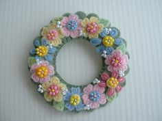 Felt Wreath by Paulette Racanelli Felt Flower Wreaths, Felt Wreath, Wreath Crafts, Felt Flowers, Fabric Flowers, Floral Wreath, Pastel Flowers, Spring Flowers, Felt Embroidery