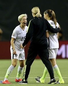 b9d005791b3 Megan Rapinoe of the United States celebrates with head coach Jill Ellis  (center) and Morgan Brian after the USA victory against Germany in the FIFA  Women s ...