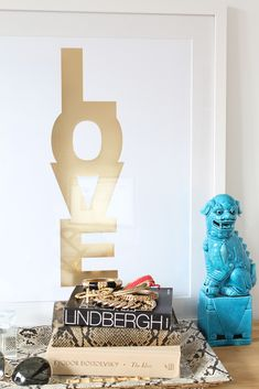 """The newest and sassiest of the LOVE Candy line - our new """"flavor"""" of our most popular print features LOVE in METALLIC GOLD on a bright white 100lb high quality stock. This letterpressed version is suitable for mounting in a dining area, office, or bedroom! ALSO available in other colors!"""