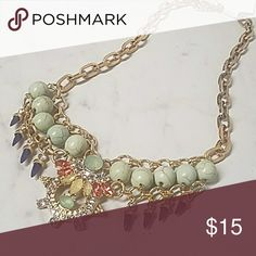 "Howlite, Crystal & Rhinestone Statement Necklace 18"" Thick Gold Chain with 5"" of ""Decorative Glam"" in this statement necklace. Light Mint Green Colored Howlite Beads, Pink & Yellow Crystals as well as Rhinestones accent this gorgeous neclace.Lobster Clasp Closure w/ 2"" extender chain. Item#N899 JesisFashionz Jewelry Necklaces"